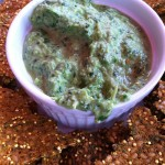 Creamy spinach and artichoke dip served with flax crackers