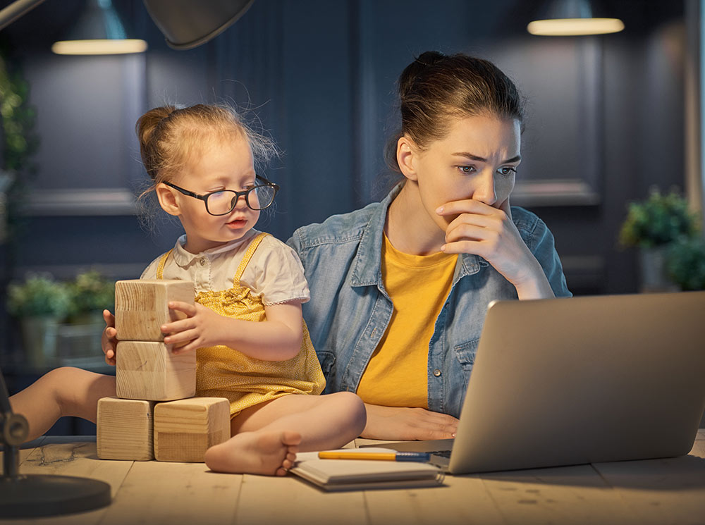 Tagging Yourself as a WAHM is Bad for Business - mother working with child at home