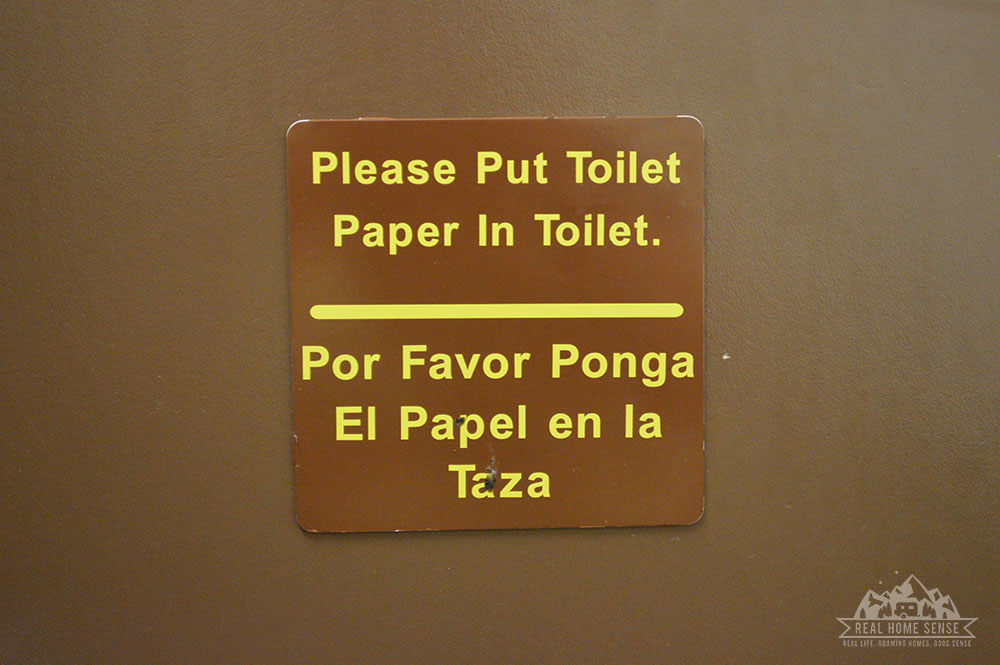 Sign to put paper in toilet